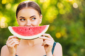 Cheerful girl with watermelon