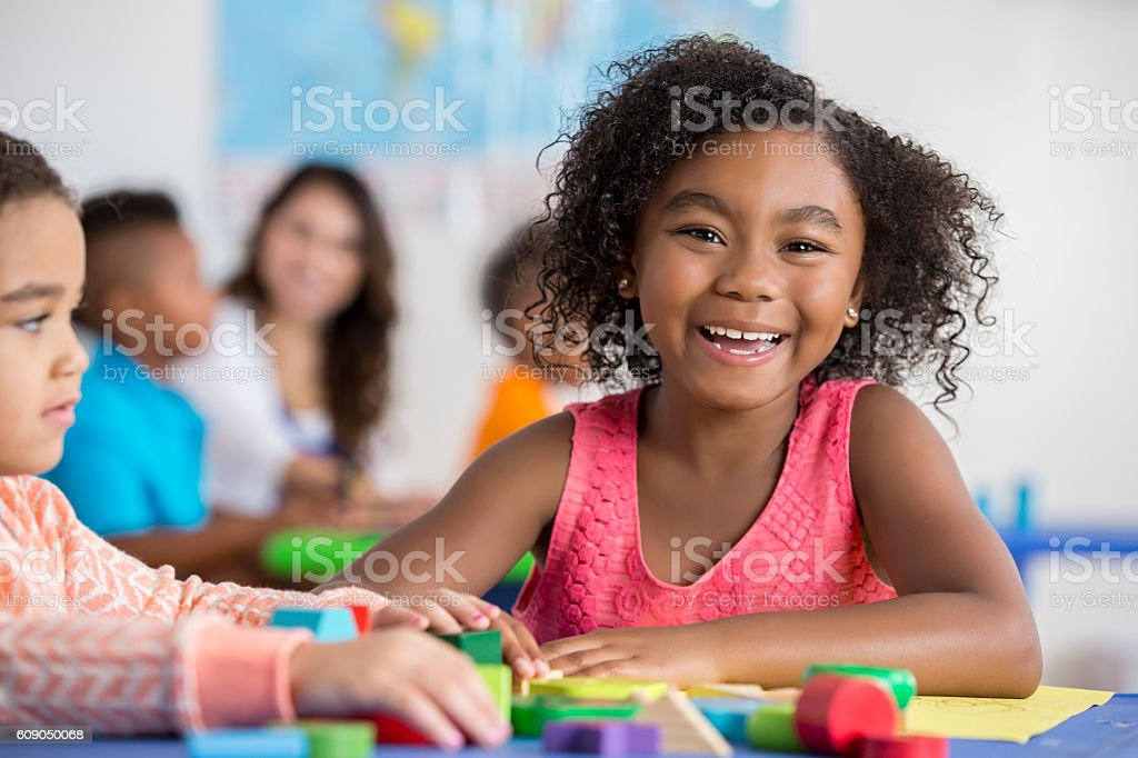 Cheerful girl works on project at school - Photo