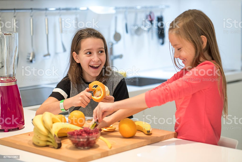 Cheerful girls in the kitchen stock photo