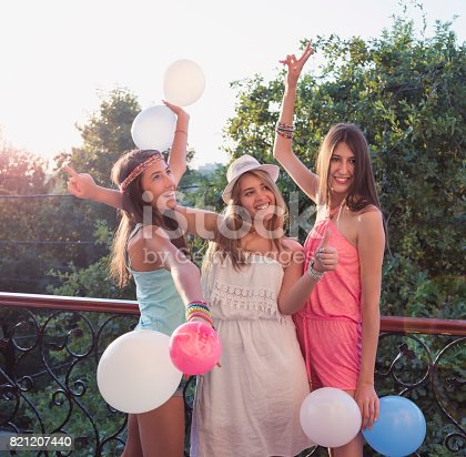istock Cheerful girls on a party 821207440