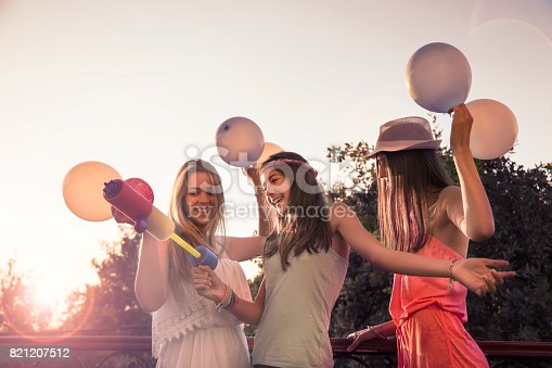 istock Cheerful girls on a party 821207512