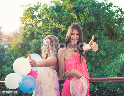 istock Cheerful girls on a party 822910168