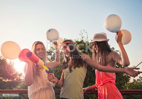 istock Cheerful girls on a party 822910344