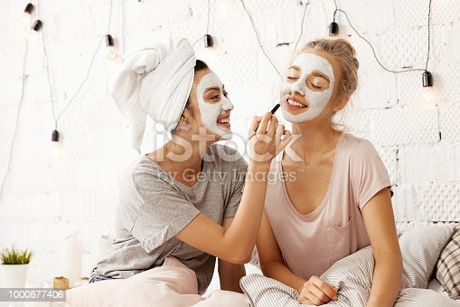 istock Cheerful girls spending time together 1000677406