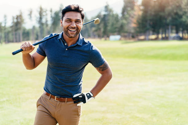 Cheerful golf player stock photo