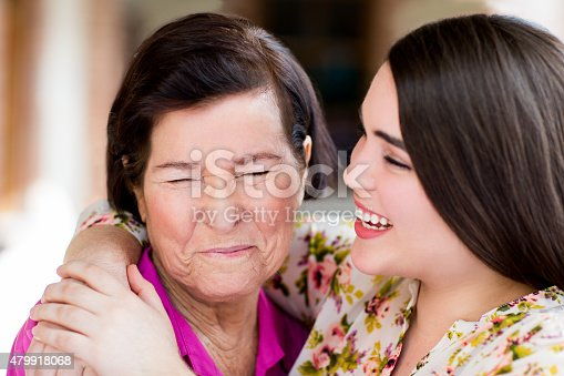 144362548istockphoto Cheerful grandmother and granddaughter 479918068