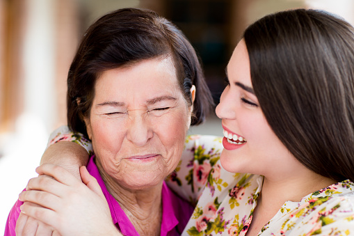 144362548 istock photo Cheerful grandmother and granddaughter 479918068