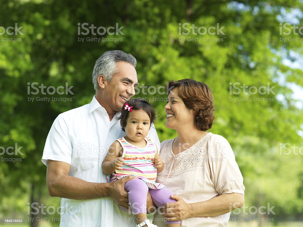 Cheerful grandparents with her granddaughter royalty-free stock photo