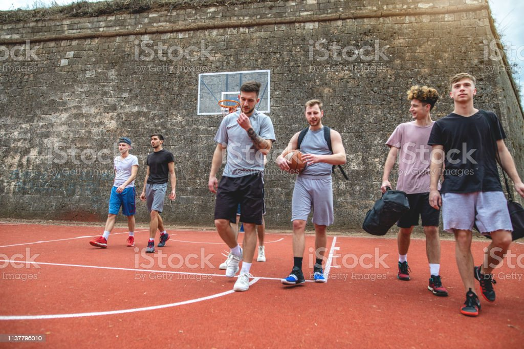 Group of basketball friends finishing with a basketball game on a...