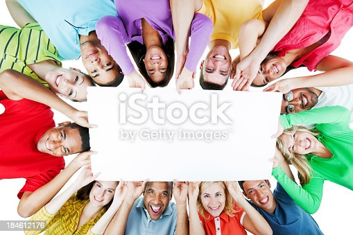 638013502istockphoto Cheerful group holding a big white paper. 184612176
