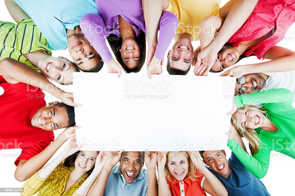 Cheerful group holding a big white paper. stock photo