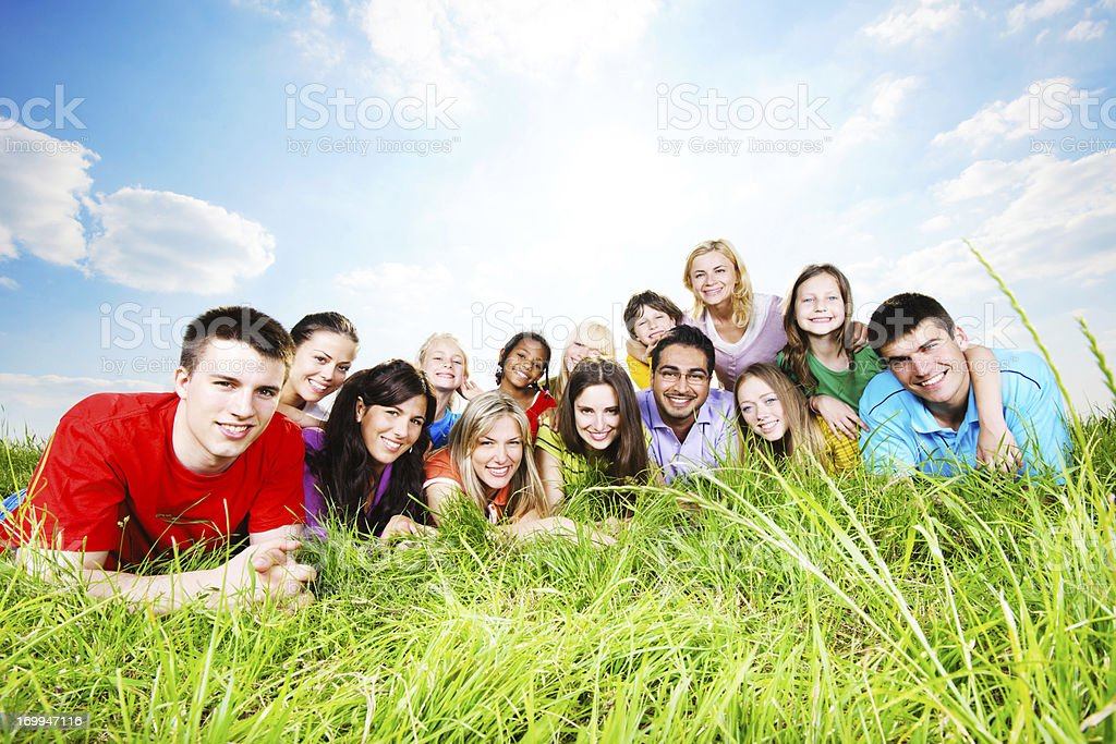 Cheerful group lying in the nature. stock photo