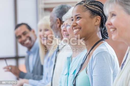 istock Cheerful group of businesspeople attend conference 667151010