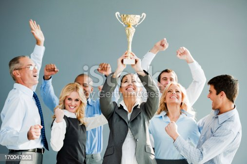 istock Cheerful group of businesspeople winning the cup. 170047553