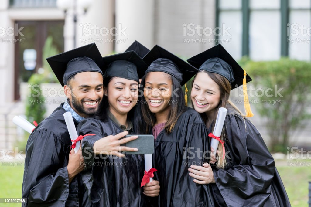 Cheerful Group Of College Graduates In Caps And Gowns Stock Photo ...