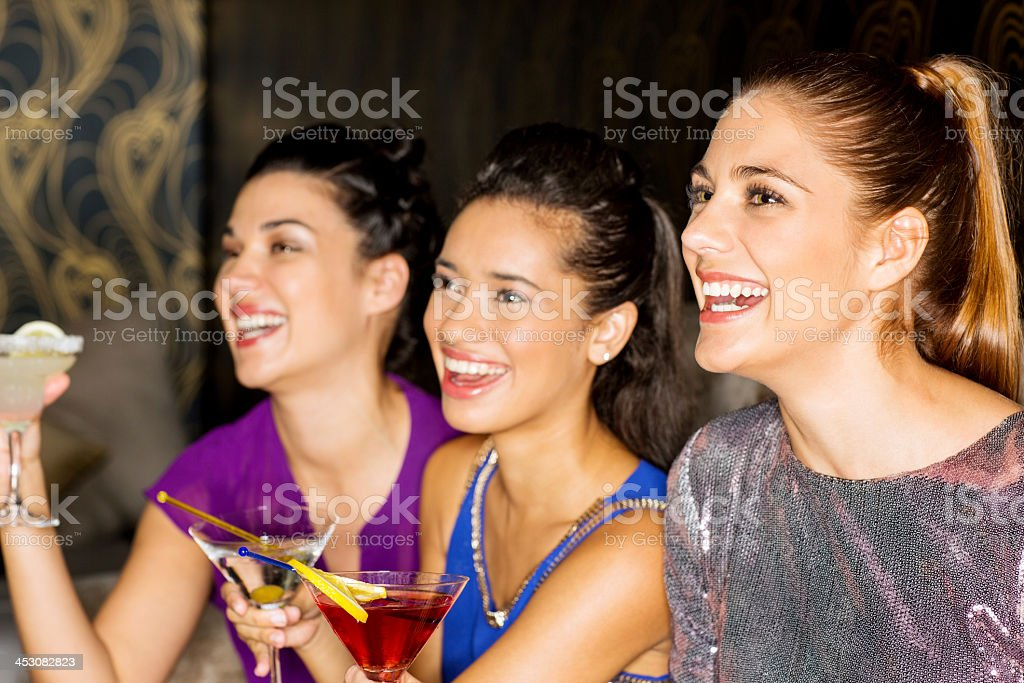 Cheerful Group Of Friends With Cocktail Drinks In Nightclub royalty-free stock photo