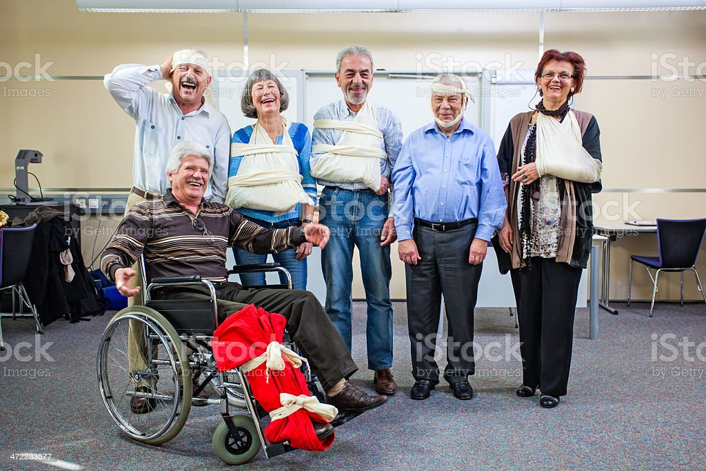 Cheerful Group of Injured Seniors after First Aid Training stock photo