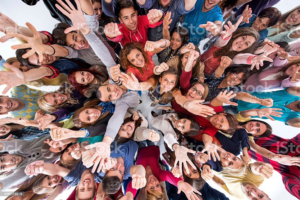 Cheerful group of mixed-age people. stock photo