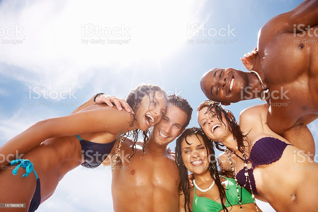 Cheerful group of multi ethnic friends together royalty-free stock photo