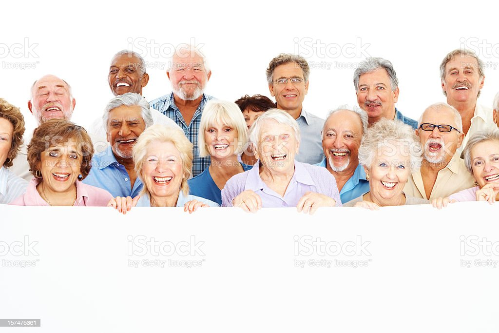 Cheerful group of old people holding a billboard royalty-free stock photo