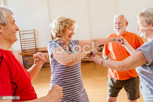 istock cheerful group of seniors practice dancing together and having fun 697566118