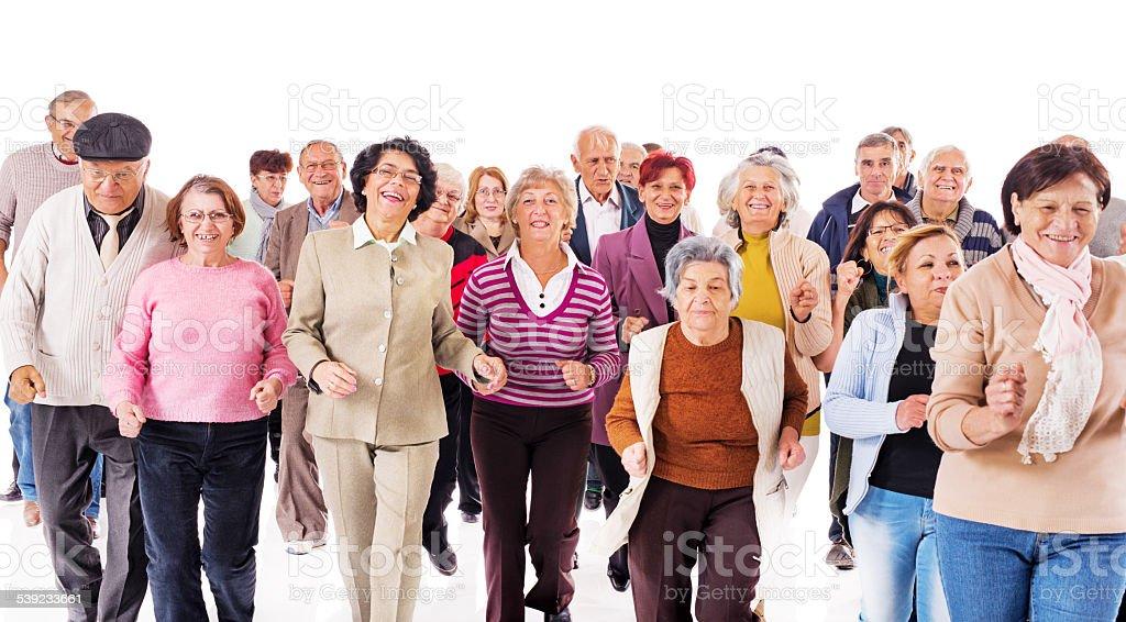Cheerful group of seniors running and having fun. royalty-free stock photo