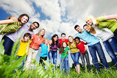 istock Cheerful group of young people looking at the camera. 184132906