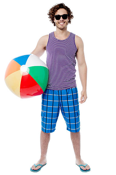 Cheerful guy ready to play beach ball stock photo