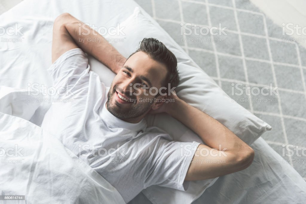 Cheerful guy waking up in the morning stock photo