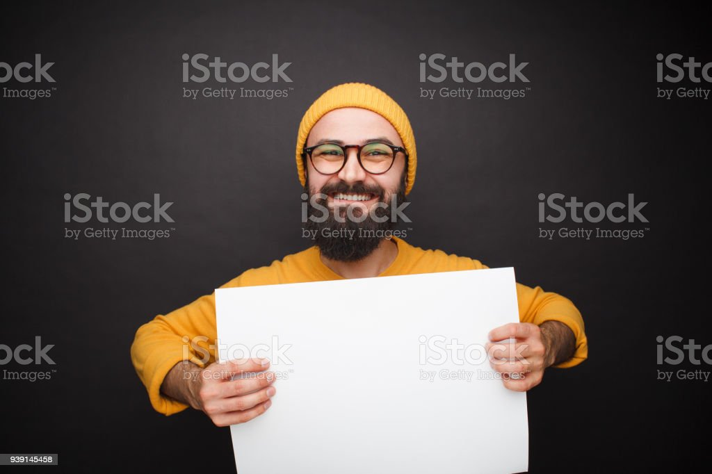 Cheerful handsome hipster with clean paper stock photo