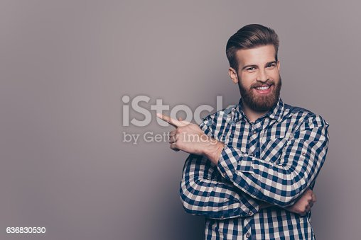istock Cheerful handsome  stylish man  pointing to the side 636830530