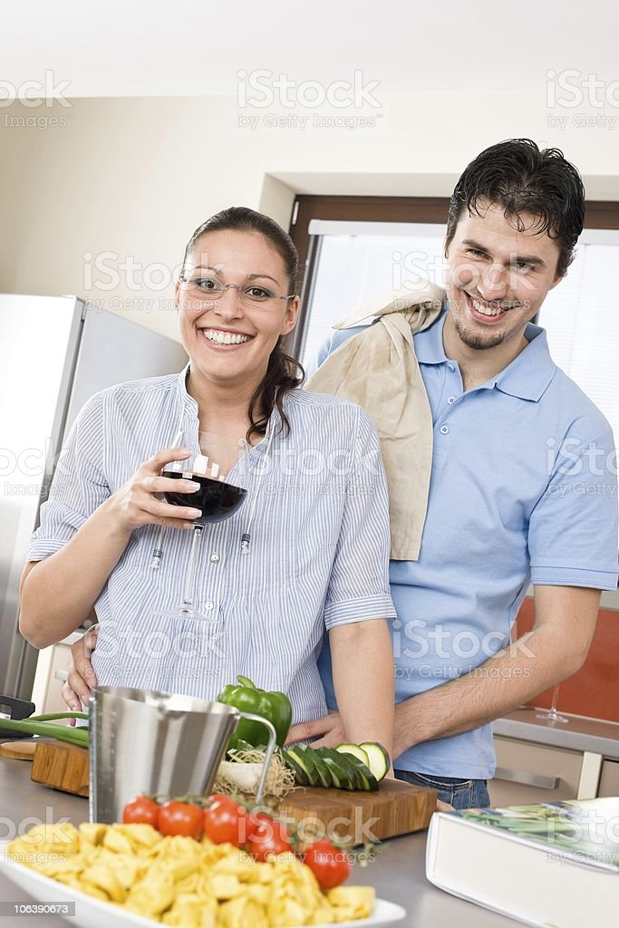 Cheerful happy couple in modern kitchen royalty-free stock photo