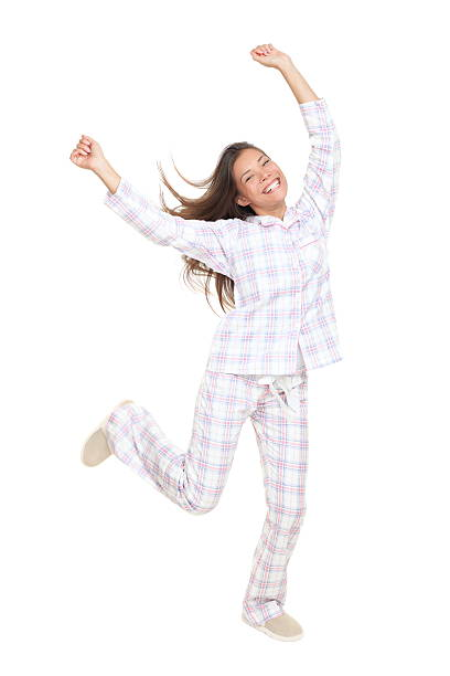 Cheerful happy dancing pajamas woman stock photo
