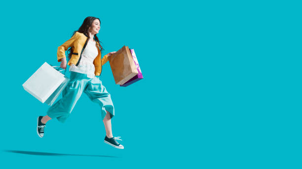 Cheerful happy woman enjoying shopping stock photo