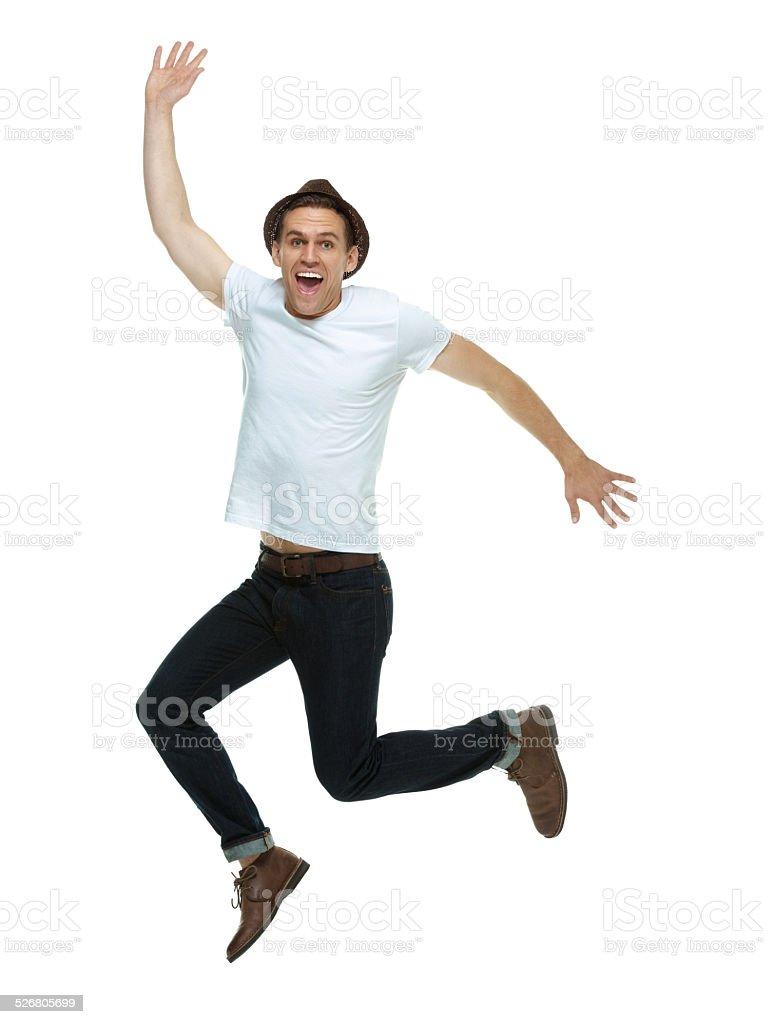 Cheerful hipster jumping & cheering stock photo