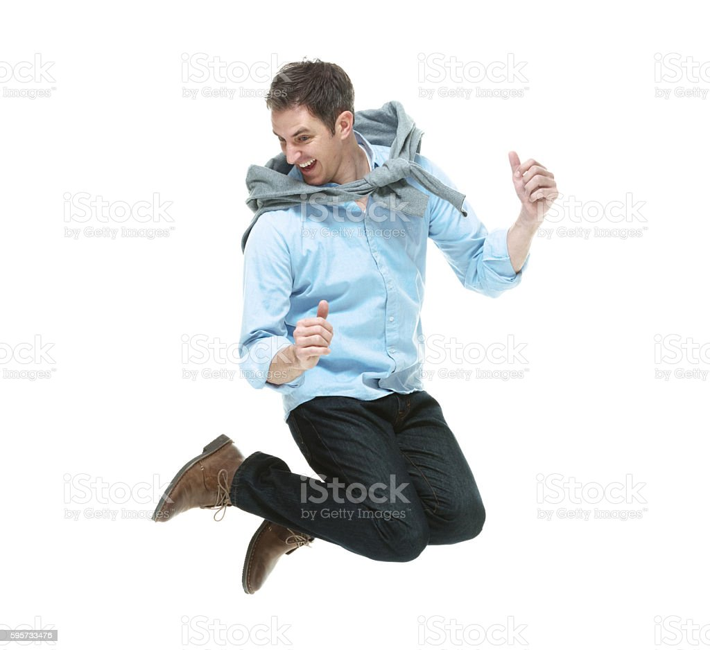 Cheerful hipster jumping stock photo