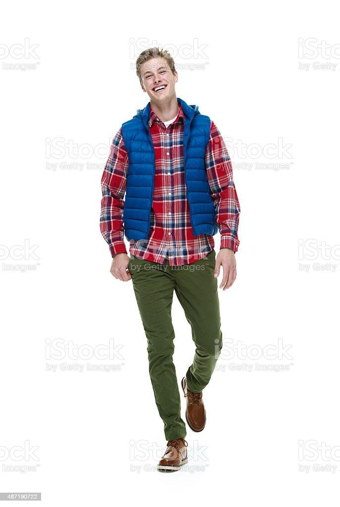 Cheerful hipster walking stock photo