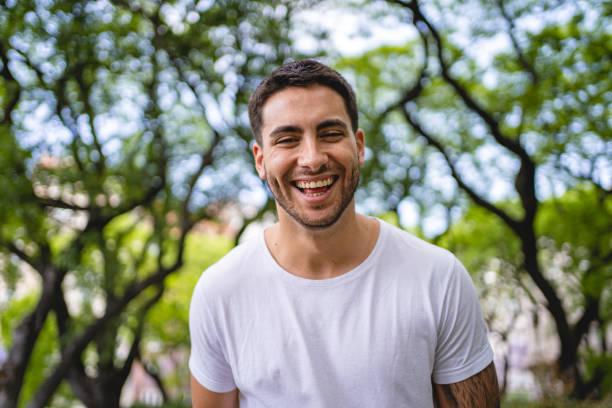 Cheerful hispanic man looking at the camera stock photo