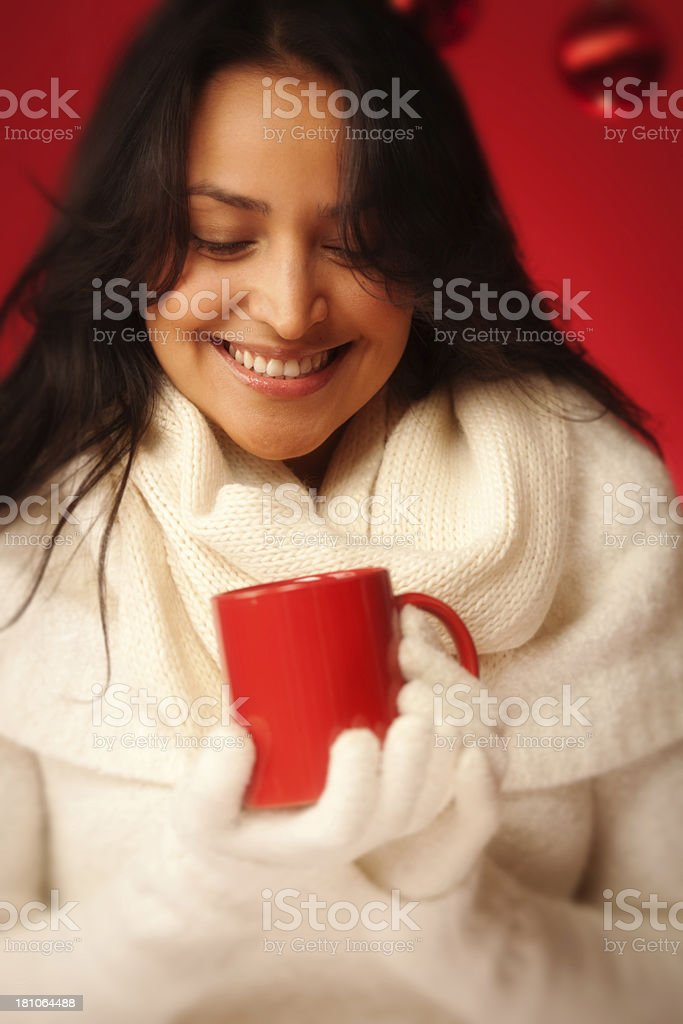 Cheerful Hispanic Woman Holding Winter Christmas Hot Drink Mug, Vertical royalty-free stock photo
