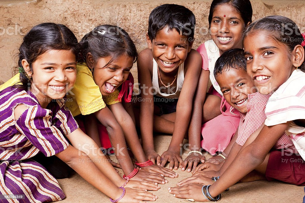 Cheerful Indian children playing in Maharashtra stock photo