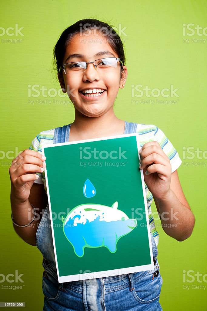 Cheerful Indian Girl Making an Appeal to Save Water stock photo