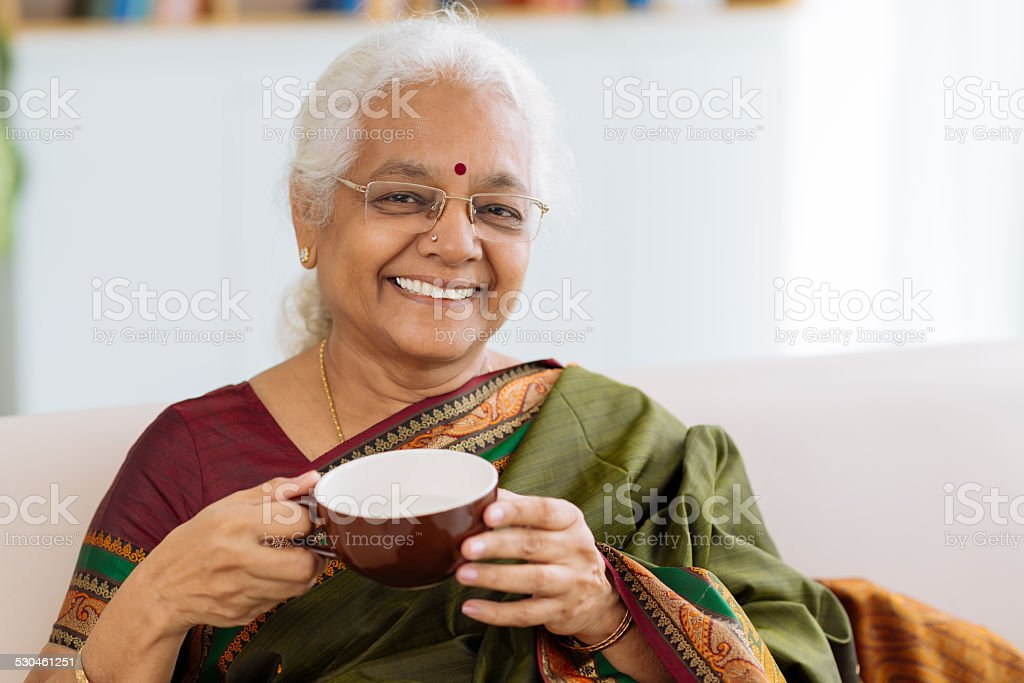 Cheerful Indian lady stock photo