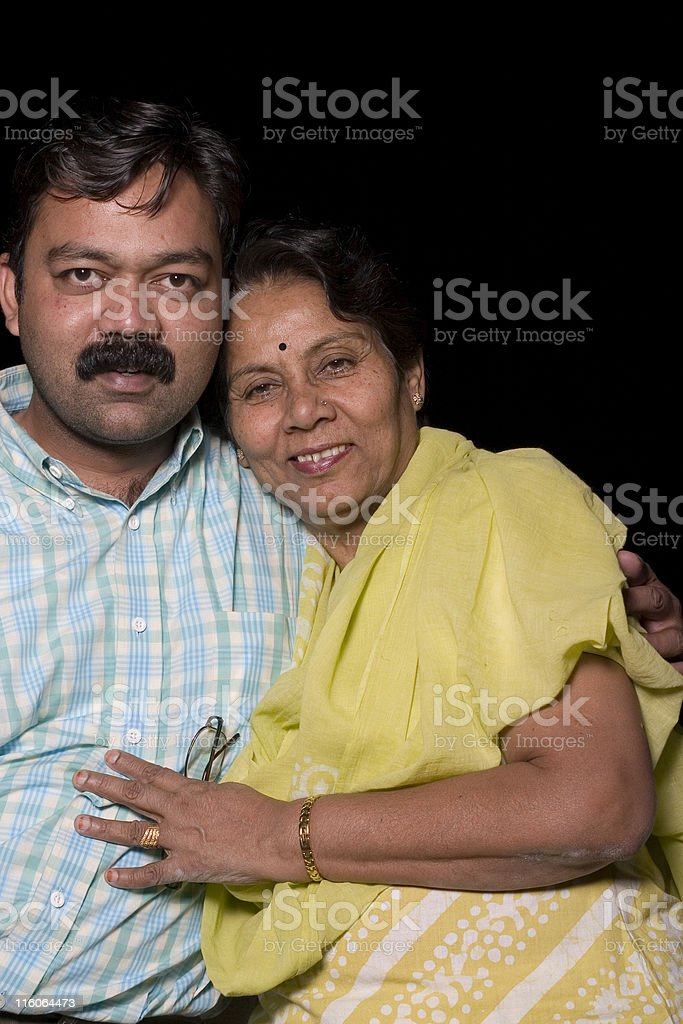 Cheerful Indian Senior Citizen Female Woman with her Son Vertical royalty-free stock photo
