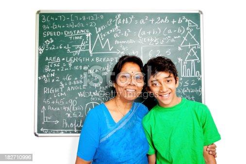 istock Cheerful Indian Senior Teacher with her Student Grandchild 182710996