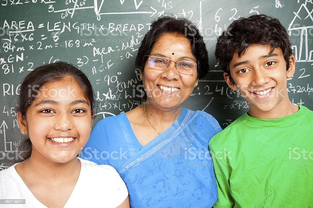 Cheerful Indian Senior Teacher with her Students Grandchildren royalty-free stock photo