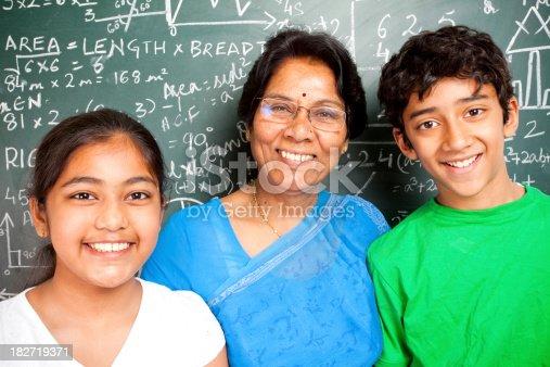 istock Cheerful Indian Senior Teacher with her Students Grandchildren 182719371