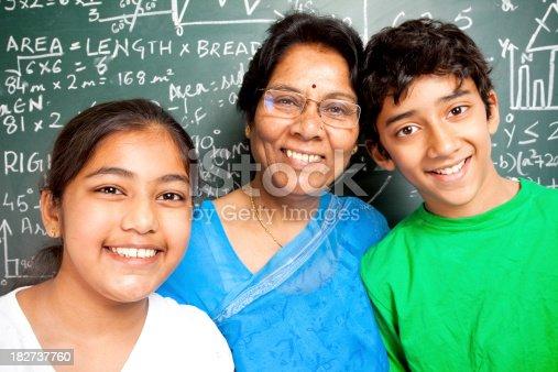 istock Cheerful Indian Senior Teacher with her Students Grandchildren 182737760