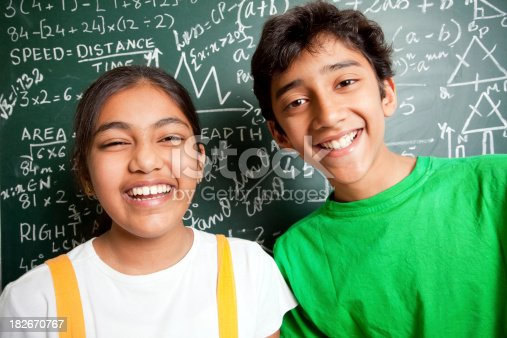 istock Cheerful Indian Teenager Boy and Girl Student with Mathematics Problems 182670767