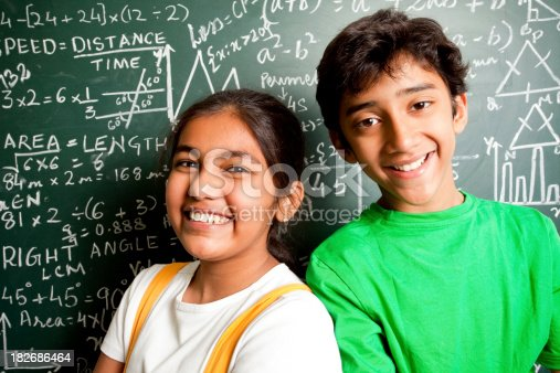 istock Cheerful Indian Teenager Boy and Girl Student with Mathematics Problems 182686464
