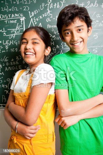 istock Cheerful Indian Teenager Boy and Girl Student with Mathematics Problems 182688025
